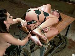 Ashli Ames and Bobbi Starr are getting naughty indoors. Bobbi restrains Ashli and attaches wires to her legs and then slams her cunt with a strapon.