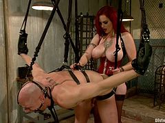 This bald guy will go through some pretty tough and extreme bondage while being face sitted and ass fucked by Mz Berlin's strapon dildo.