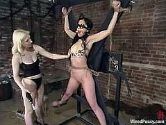 Shade Paine is getting toyed and tortured with other kinky devices, including a sybian, in this BDSM lesbian video packed with rope bondage action.