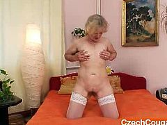 Watch this horny mature blonde spreading her legs and showing her hairy pussy in white stocking.She spreads her hairy pussy lips wide and drills it with big dildo