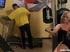 A busty blonde and a cute brunette are having fun with two dudes in a gym. They let the men rub their shoulders and feet and moan sweetly with pleasure.