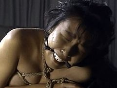 Horny asian slut gets fucked during top bondage and BDSM porn session