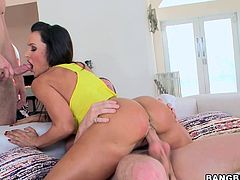 A stunning brunette milf with huge tits and huge ass sucks on two pricks and has them shoved balls deep into her holes. Check it out!