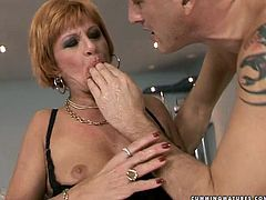 Voracious red-haired mature in steamy black lingerie gets her soaking vagina fisted by aroused daddy before she stands in doggy pose to get pounded with dildo machine.