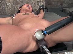 This bondage session with Jandi Lin has the hot babe getting nipple torture as she's tied and fucked by a machine.