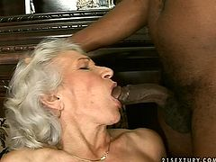 Caucasian granny with big saggy boobs is drilled in her cunt with powerful sex machine. Meanwhile she is getting face fucked by horny black stud.