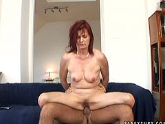 Disgusting red haired bitch rides a strong dick and her tits bounce heavily