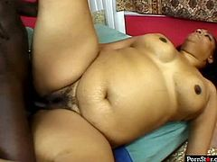 Voracious black whore with fat belly and rounded ample butt is getting nailed bad in her hairy muff from behind. Dark skinned dude also licks her cunt properly in Pornstar video.