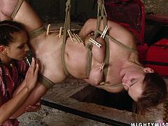 Stupid MILF is not afraid of pain at all, so she is hanged to the ceiling with her big pink nipples squeezed with pegs by pitiless domina before she lies on the floor with legs wide open to get dildo fucked in sultry lesbian sex video by 21 Sextury.