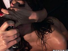 Ugly brunette MILF gets bandaged before she stands in doggy pose to get her cunt pounded with a sleek black dildo held by pitiless domina in BDSM-styled sex video by 21 Sextury.