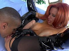 Veronica Avluv is a nice looking red-haired milf with perfect big hooters. She shows off her lovely melons as she gives head to hard dicked guy with her long latex gloves on. Then he licks her mature pussy.