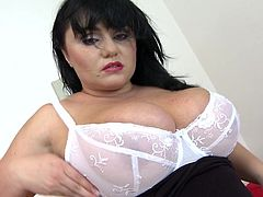 Sara has a pair of huge boobs and an even bigger sex drive. She knows that those melons make men horny everywhere she goes and takes advantage of that. The dark haired mature woman slowly takes off her clothes and then plays with her breasts in front of us. Will she reveal more and is she gonna receive a hard cock?