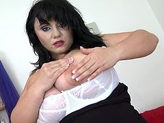 sensual mature woman shows her tits