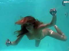 Redhead in cute bikini goes swimming