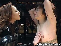 Watch a sexy Asian brunette slave girl getting burned with candle wax and humilliated by her evil mistress. Then she's ready to masturbate her hairy clam into heaven.