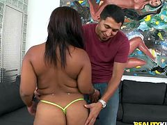 Reina is a black slut with a pair of hot breasts and a big naughty round booty that needs a few slaps and a hard cock inside it. Juan takes off her pants and grabs the bitch by her ass making her hornier! She allows him to play with that booty and her boobs and then sucks his dick with passion.