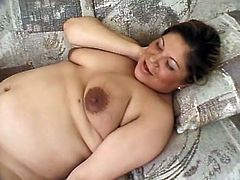 Nothing makes mom Teal happier then a hard cock, well perhaps two hard cocks. She feels horny and demands a good hard fuck, nothing that these two guys can't handle! Teal undresses and massages her big soft boobs and that pregnant belly until one of them licks her bald cunt while the other feds her with cock