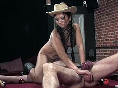 Horny chick in cowboy hat gives a blowjob to Wild Bill and then toys him with a strap-on on a billiard table. After that she also gets fucked cowgirl.