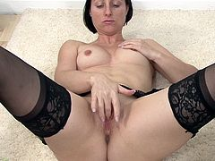 A short-haired brunette mature bitch gets naked and inserts a hard toy in her fucking snatch, check it out right here! It's hot!