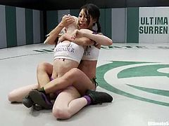 Cute blonde Ashley Jane is having a fight with Tia Ling on tatami. The girls wrestle with each other energetically and then Tia pounds Ashley's snatch with a strapon.