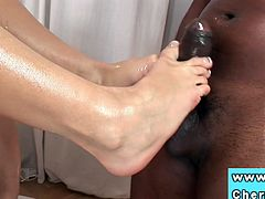 Cute babe Cherry Jul is messing around with a massive black cock. She rubs it with her sexy feet and can't wait to take it into her tight muff!