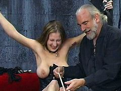 Young babe with big tits gets dominated by older guy in BDSM porn session