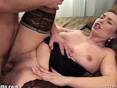 This horny milf enjoys to be fucked and filled with a big load of cum. All the cum is leaking from her pussy.