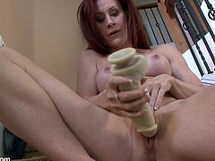 Check out this solo video where a busty redhead milf has a great time masturbating with a dildo on a flight of stairs.