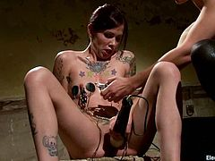 Check out the kinky electrical torture Bobbi Starr is giving Krysta Kaos in this lesbian femdom video with wicked action.