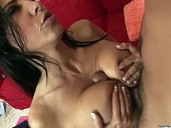 Veronica Rayne has a jet black hair and big juicy boobs. This gorgeous brunette is a seasoned pro when it comes to pleasing men. She gets down on her knees and gives her lover one hell of a blowjob. Then she pleases him with a titjob.