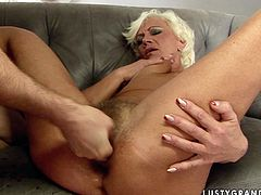 This granny has a huge sexual appetite! Sex-starved harlot spreads her legs wide to let her lover drill her asshole in missionary position. Then she lets him finger her butthole.