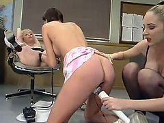 This class got out of hands when a blonde girl gets tied up by another two who then proceed on toying and strapon fucking her!