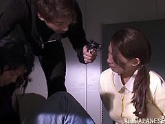 Some invaders take hostages in an office. There are plenty of sexy girls there. So, invaders take the advantage of such a situation. One of the chicks gives a blowjob and then gets fucked in the eyes of other hostages.