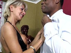 Klarisa is blonde and damn experienced. The whore knows a lot when it's about sucking and fucking a hard one. Check her out what she does with this black male. The blonde cunt wants his big black dick and does her ways until she receives it. Then she kneels, opens her mouth and begins sucking it like a whore