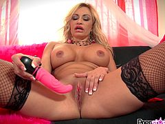 Sexy blonde dressed in black stockings enjoys her new toy during hot solo