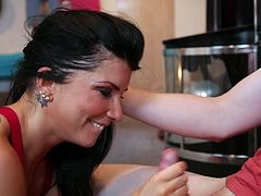 Look how fascinatingly this brunette milf is seducing this guy. She performs a striptease dance and raises his dick. Now that his cock is rock solid the brunette uses her lips to solve that. She swallows his penis and does it with a smile on her slutty face.
