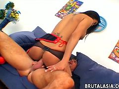 After Lucy Lee rides this guy's cock, he pours a lot of cum on a glass table and she licks it. Then he fingers her tight ass hole.