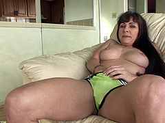 A hot old gash spreads her legs for the camera and shows off her mature pink-ass pussy, hit play and check it out! It's awesome!