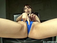 Slutty Japanese chick is having some fun indoors. She pleases herself with fingering and then pokes a rubber dildo deep into her snatch.