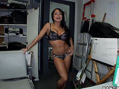 Brunette babe with big boobs strips her clothes off in a storeroom. Then she lies down on a table and gets her shaved pussy drilled by her colleague.