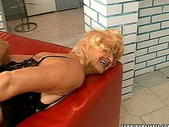 Torn slut of respectful age is still lustful woman craving for orgasm. So she is up for kinky action on cam. She bends over getting fucked with sex machine from behind.