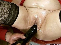 Ardent flamboyant brunette BBW in passionate red lingerie and stockings gets her soaking bald twat drilled with sleek dildo before she gets it tickled with a vibrator.