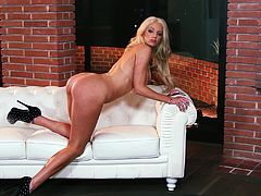 Beautiful blonde Nicolette Shea is having a photo session for Playboy. She strips sexily and then boasts of her nice slim body and well-rounded ass.