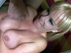 Nasty blonde whore with big natural tits is stroking hard dick intensively while giving awesome blowjob. She also sucks balls and licks ass hole of her lover.
