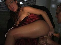 Raunchy hooker in devil's costume is getting her cunt drilled with big dildo. Then, her tight ass hole is also stuffed with dildo.