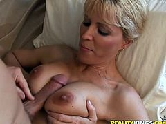 This slutty MILF always watch whom to fuck. This time she seduces some seller in a boutique. They go to her house and fuck there. She gives him hot blowjob and then gets fucked reverse cowgirl. She also gets a facial.