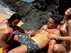 Two awesome brunettes Simonne Style and Sonia Carter are having fun with some man on a beach. They suck his dick devotedly and then take it in their amazing butts and jump on it.
