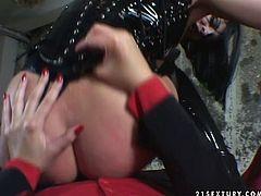 Gothic slut is wearing latex corset and jackboots. She gets on top of black strapon riding it actively in POV. Then she is screwed hard in doggy position.