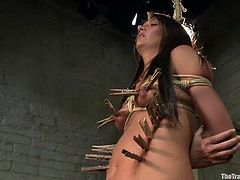 Sexy brunette Cassandra Nix strips and shows her nice body to some guy. The man binds the chick, plays with her tits and then pinches her pussy and smashes it with a dildo.