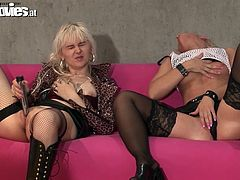 Look at these two sexy blonde playing with their vagina's. What dirty and kinky sluts they are! One uses a silver dildo and the other uses her fingers to get wet and flick her bean. These sluts like to watch each other masturbate.